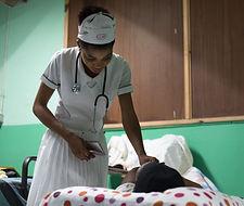 A nurse checks on a patient at bethesda Medical Center