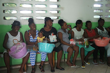 Expectant mothers with a gift from Bethesda Medical Center in Haiti