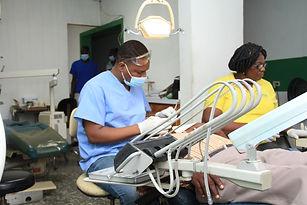 A dentist checks his patient's teeth at Bethesda Medical Center in Haiti