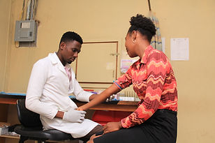 A doctor checks his patient's blood pressure at a clinic in Bethesda Medical Center, Haiti
