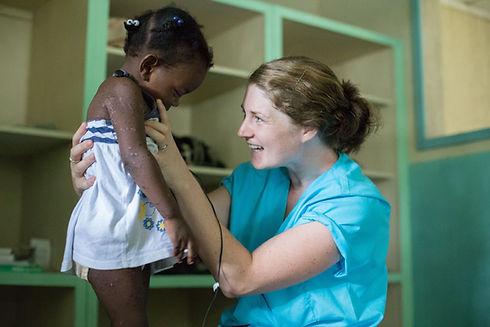 A physio checks a little girl at Bethesda Medical Center in Haiti.