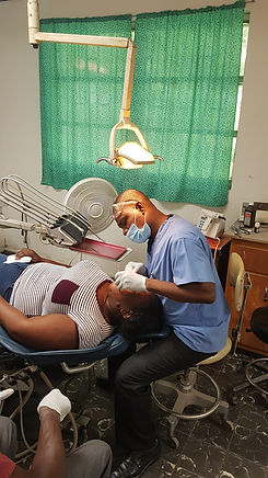 A male dentist examines the teeth of his patient at Bethesda Medical Center in Haiti