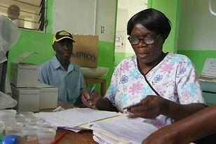 A nurse checks patient's details at Bethesda Medical Center in Haiti