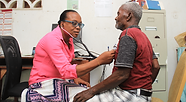 A female doctor listens to an elderly man's heart with a stethoscope at Bethesda Medical Center in Haiti.