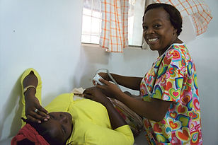 A nurse performs an ultrasound on a mum-to-be at Bethesda Medical Center, Haiti