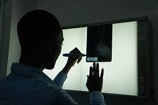 Checking an xray at Bethesda Medical Center in Haiti