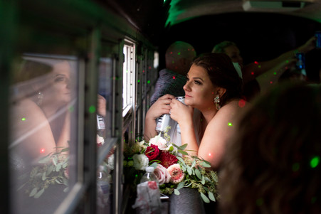 bride on a party bus on wedding day
