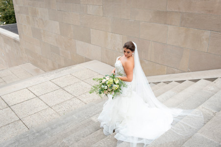 picture of bride on wedding day holding flowers