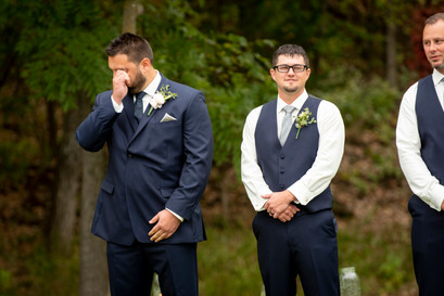 groom crying at first look on wedding day