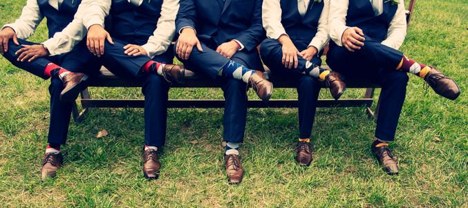 wedding photo of groomsmen's socks