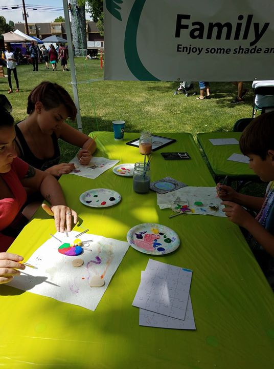 Painting wind chimes at Sand in the City