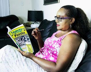 lady enjoying Jamaica puzzles