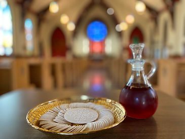 Bread and wine with rose window backgrou