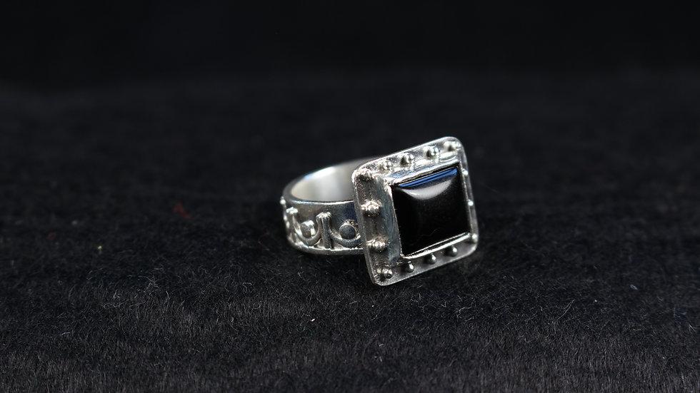 Rectangular black Onyx ring.