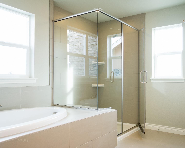 Semi frameless shower enclosure