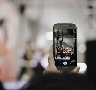 Filming a performance with mobile phone