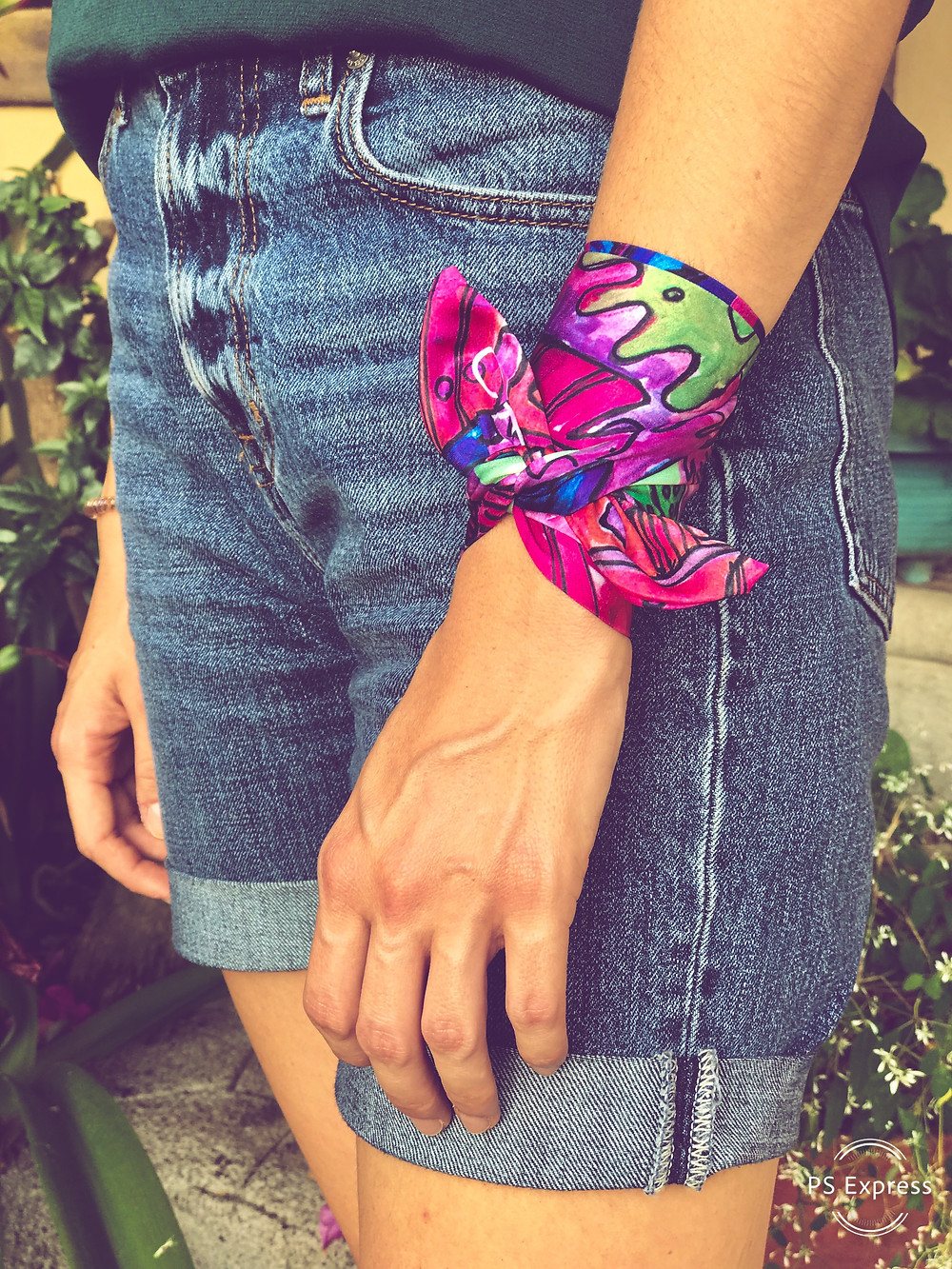 CARMENTA - model wearing wrist ribbon knot tutorial, Costa Rica design and art printed on fabric