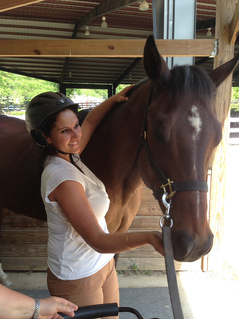 Thanking her horse after a lesson