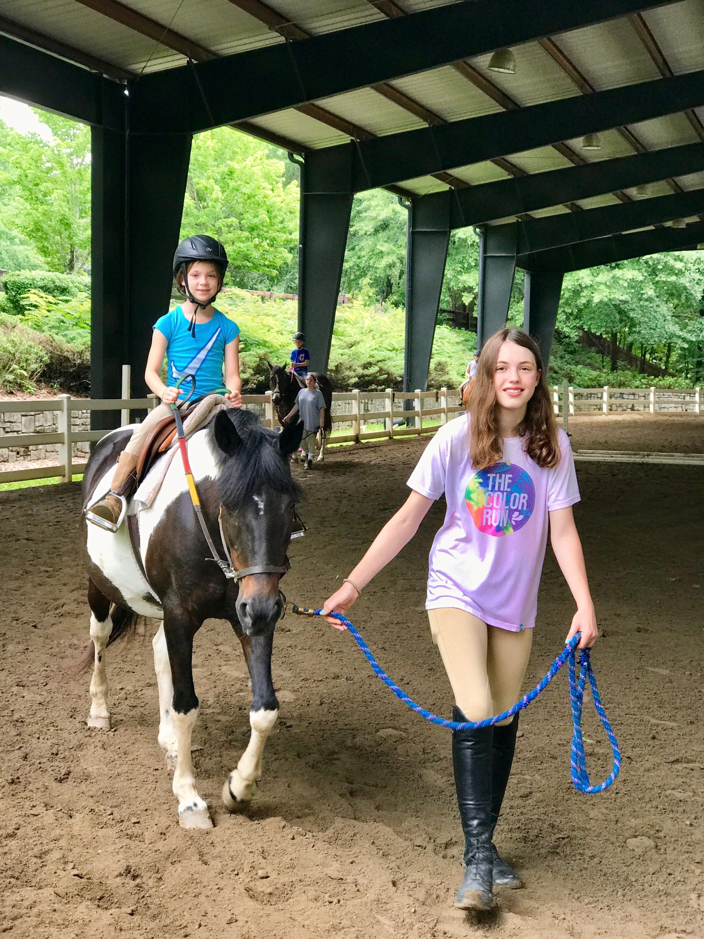 Young counselor and camper on Tilly!
