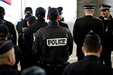 1255966-french-police-officers-listen-to