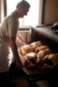 3rd generation owner, Ike Fry, roasting turkeys.