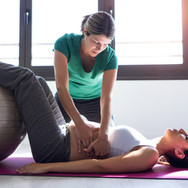 physiotherapist-helping-to-beautiful-pre
