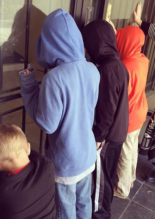 me boys praying over building.jpeg