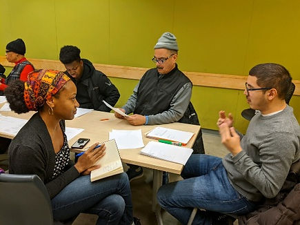 Program instructor is helping a community member out with literary art.