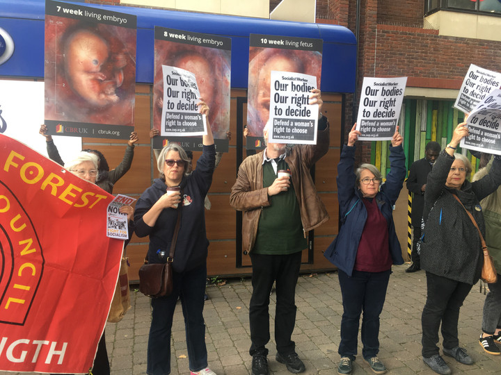WHITE SOCIALIST WORKERS BLOCK BLACK PRO-LIFERS AS COPS STAND SILENT
