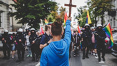 15-year-old boy holding crucifix blocks LGBT march in Poland
