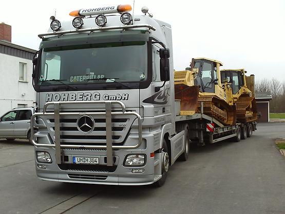 Transportank. CAT D5M+Komatsu D41-E6 200