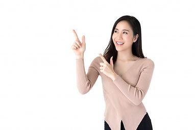 beautiful-young-asian-woman-pointing-han