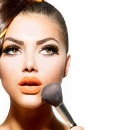 Beauty Girl with Makeup Brush. Bright Holiday Make-up for Brunette Woman with Brown Eyes. Orange and