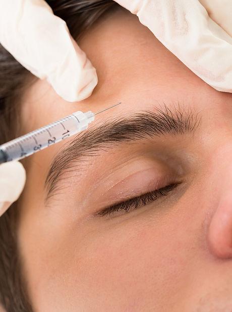 bigstock-Man-Having-Botox-Treatment-9992