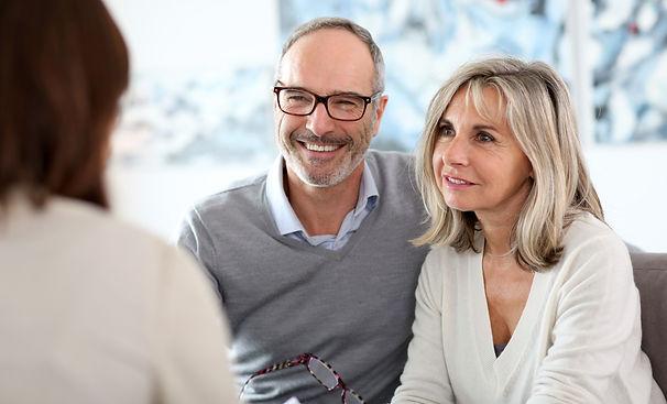Senior couple meeting financial adviser