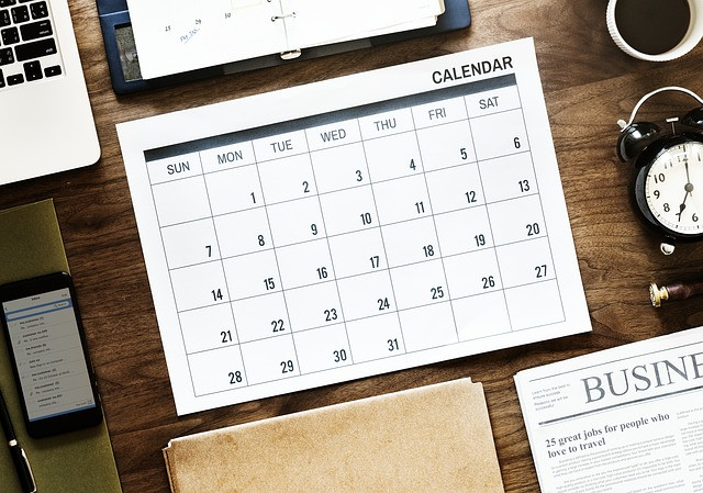 Calendar on desk with other objects