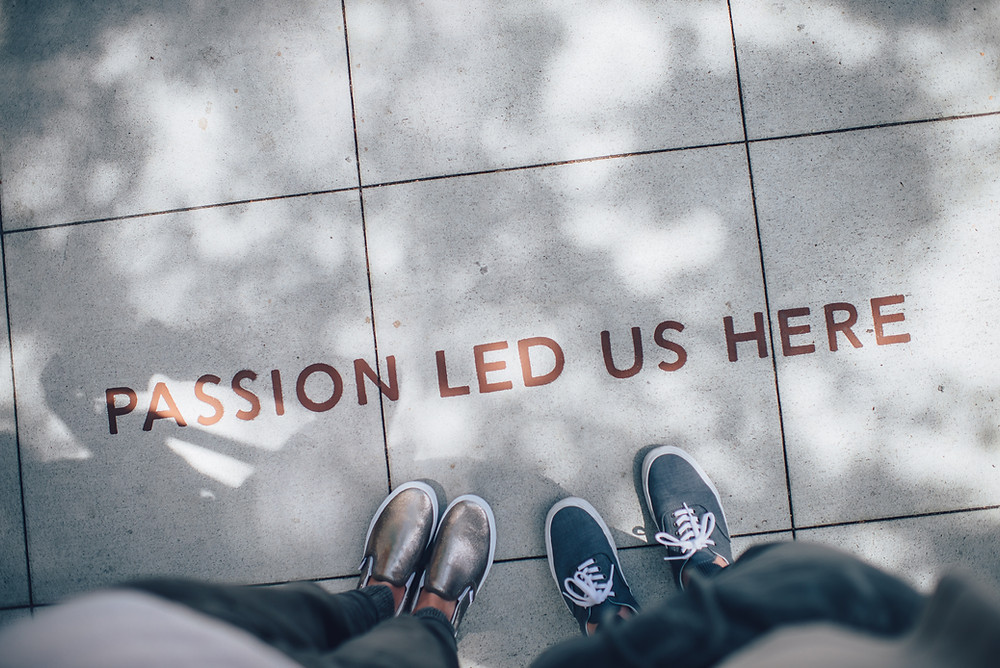 Passion led us here writing grey tile Crisp Text gives back