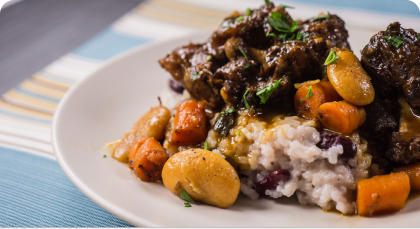 Melt in your mouth oxtail served with rice& veggies