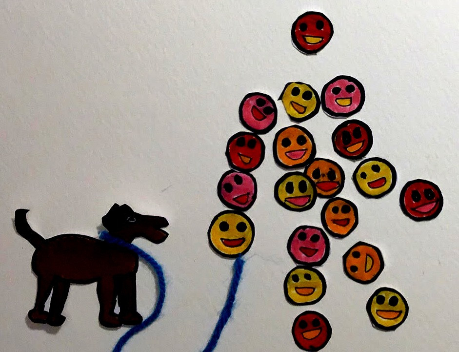 Happy emojis taking a dog for a walk.