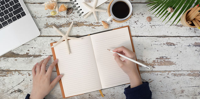 person-holding-white-pencil-writing-on-notebook-3740398.jpg