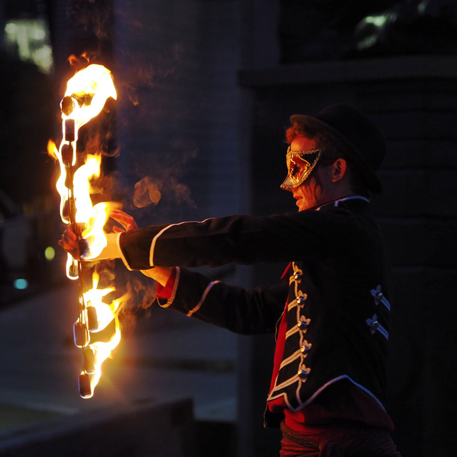 Costumed fire performer show