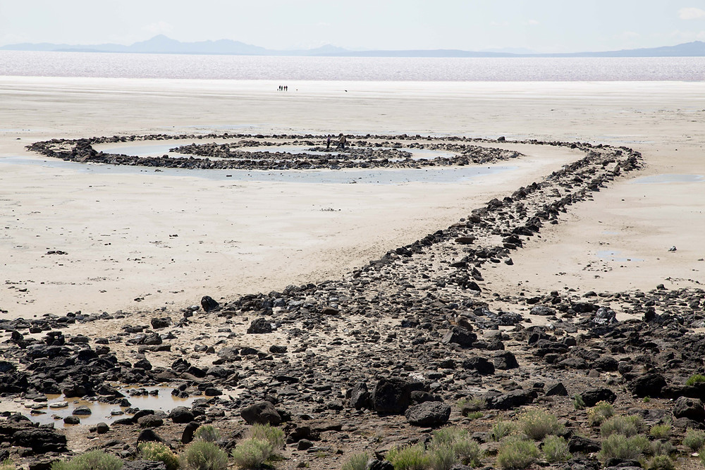 At the north end of the Great Salt Lake is an earthwork sculpture of basalt rocks, mud and salt crystals by the artist Robert Smithson