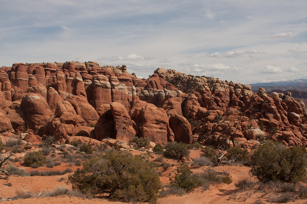 The Fiery Furnace got its name from its red rock spires that glow red at sunset in the autumn months.  It is located in Arches National Park near Moab, Utah