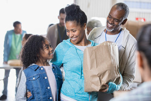 multigenerational-family-receiving-food-donations-during-food-bank-picture-id946334536.jpg