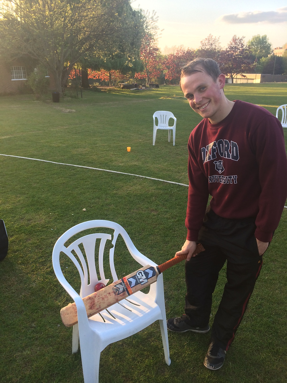 Noah Hillyard and the chair broken by his six that effectively sealed victory at Streatham & Marlborough