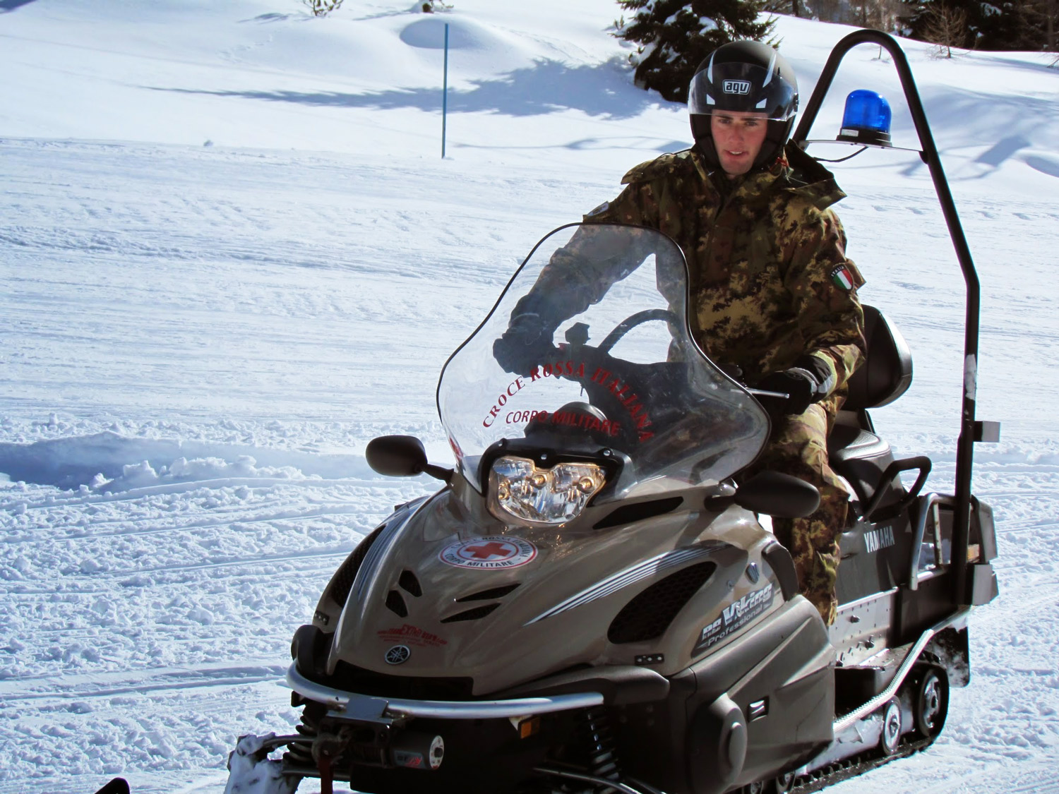 Italian Red Cross army private riding a snowmobile