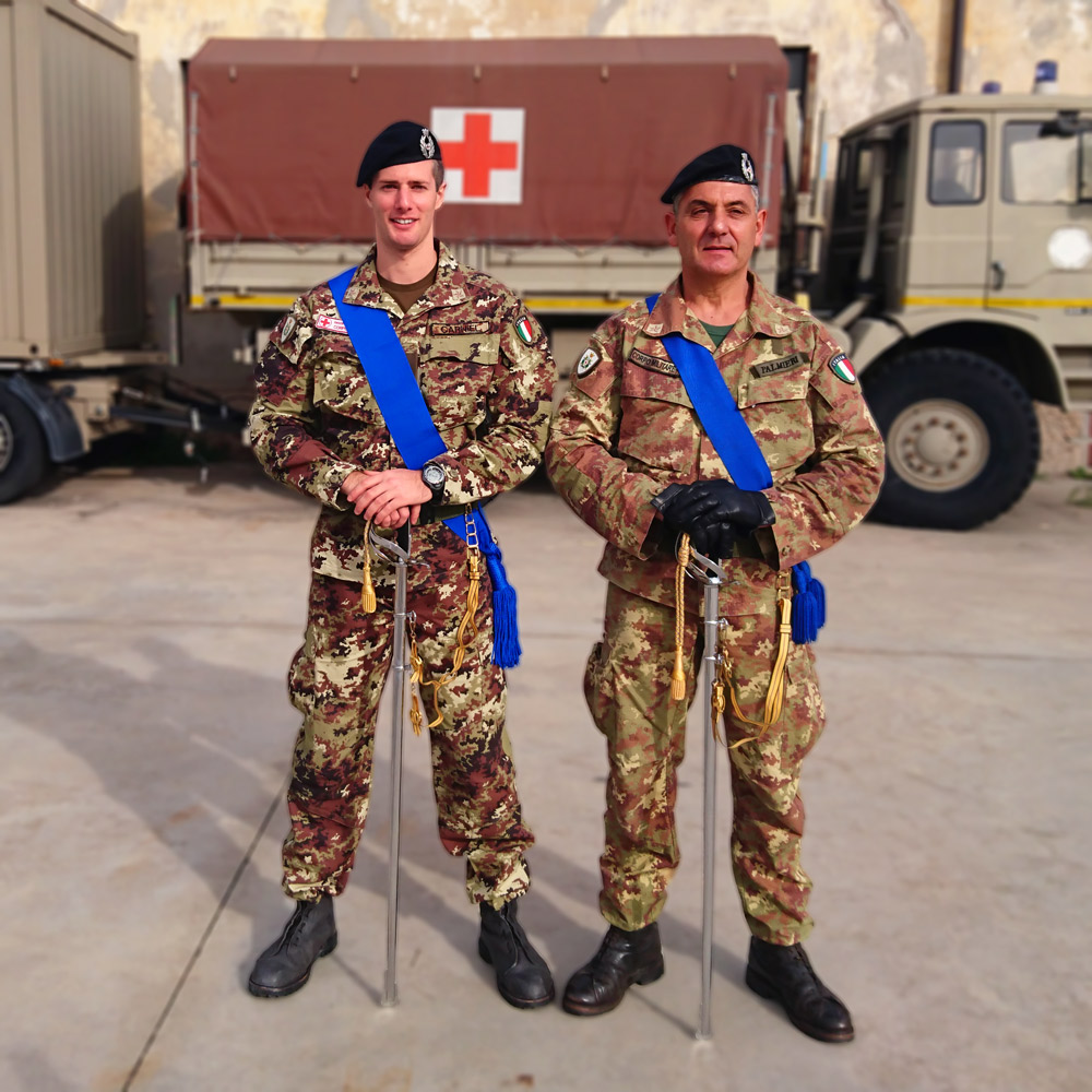 Two Italian Red Cross army officers with sabers and camouflaged uniforms