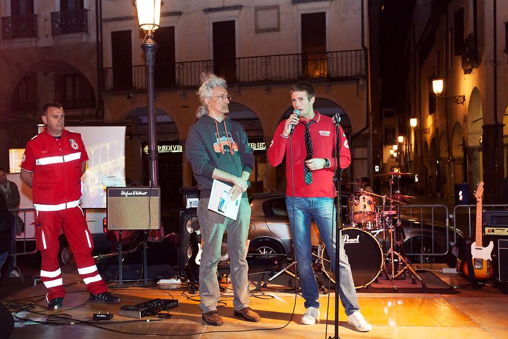 An Italian Red Cross volunteer, Alberto Carniel, is public speaking in Piazza delle Erbe, Padua (Italy)