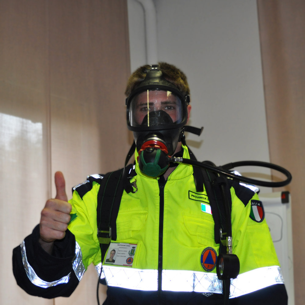 Italian Civil Protection rescuer with a gas mask and oxygen tank