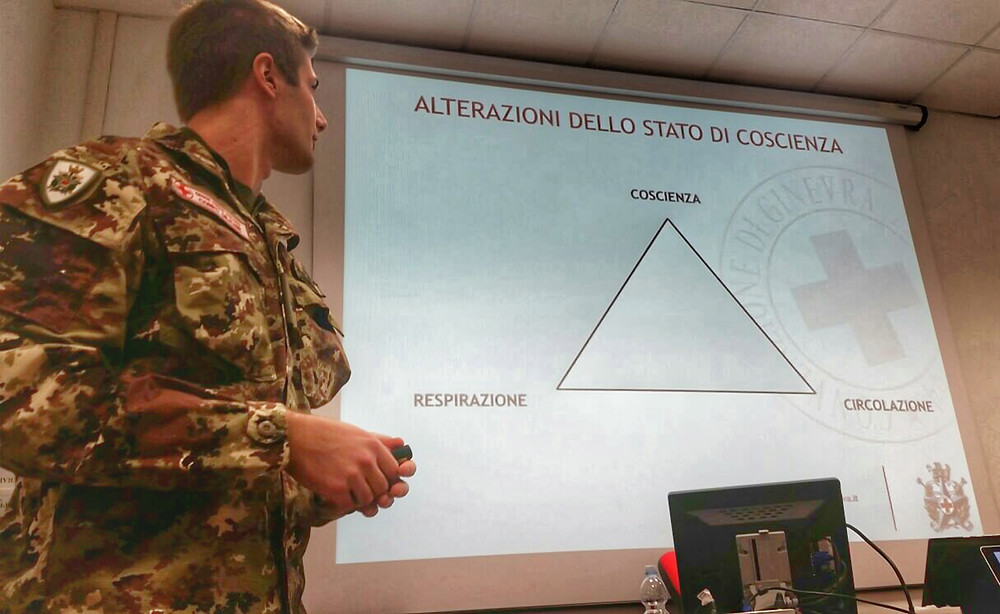 Italian Red Cross army lecturing on how to treat sudden illnesses and illnesses for environmental reasons